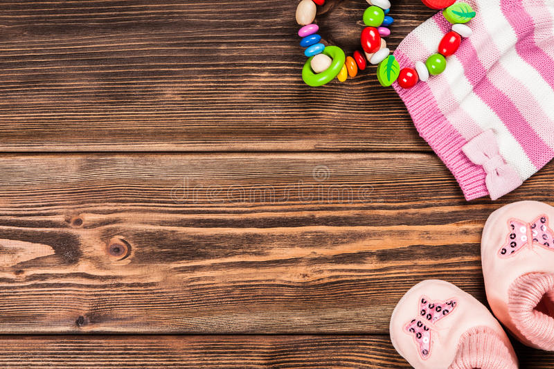 Baby clothes on wooden background.  stock photography