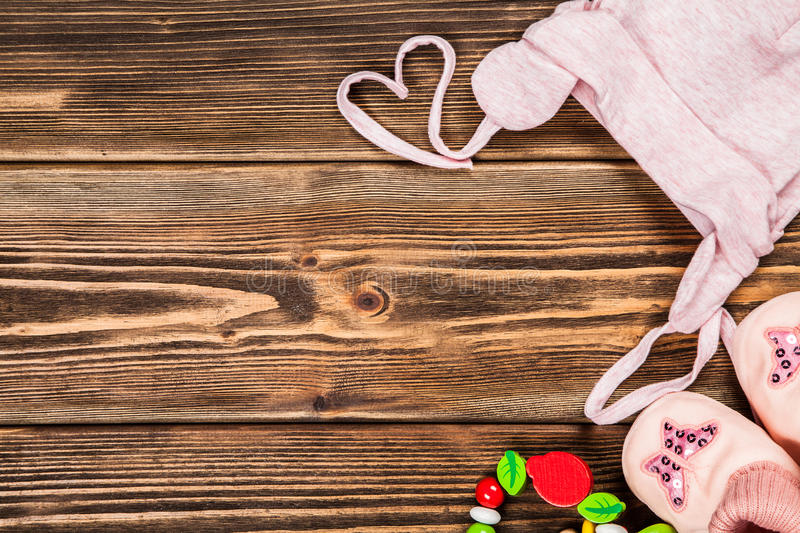 Baby clothes on wooden background.  royalty free stock images