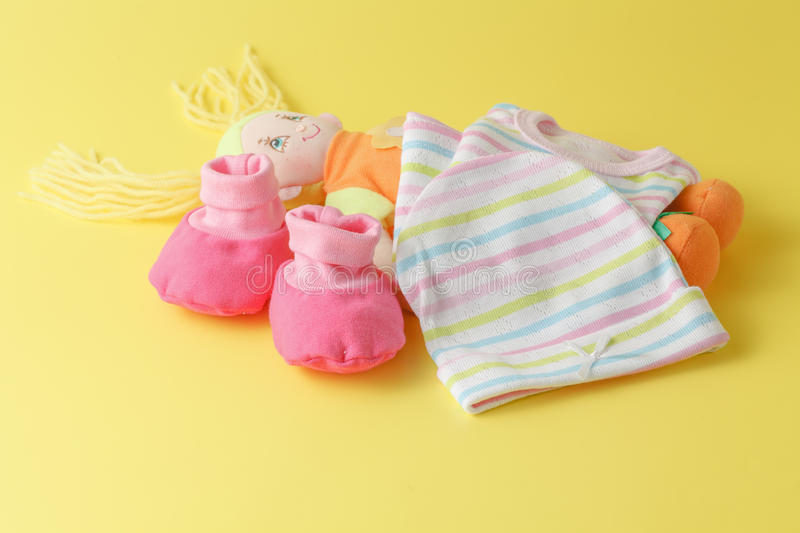 Baby clothing and doll royalty free stock images