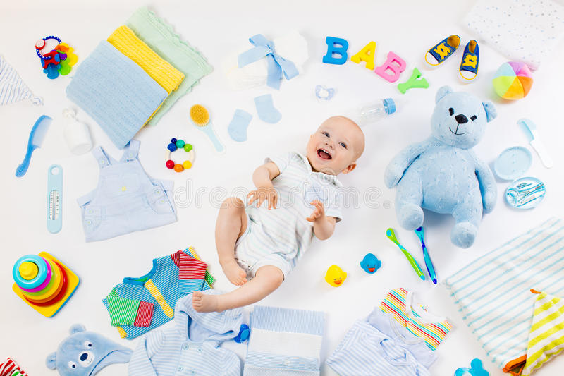 Baby with clothing and infant care items stock image