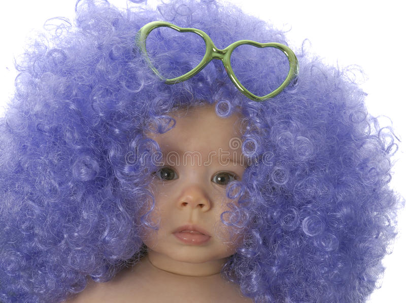 Baby clown. Seven month of baby wearing clown wigh with heart shaped glasses stock images