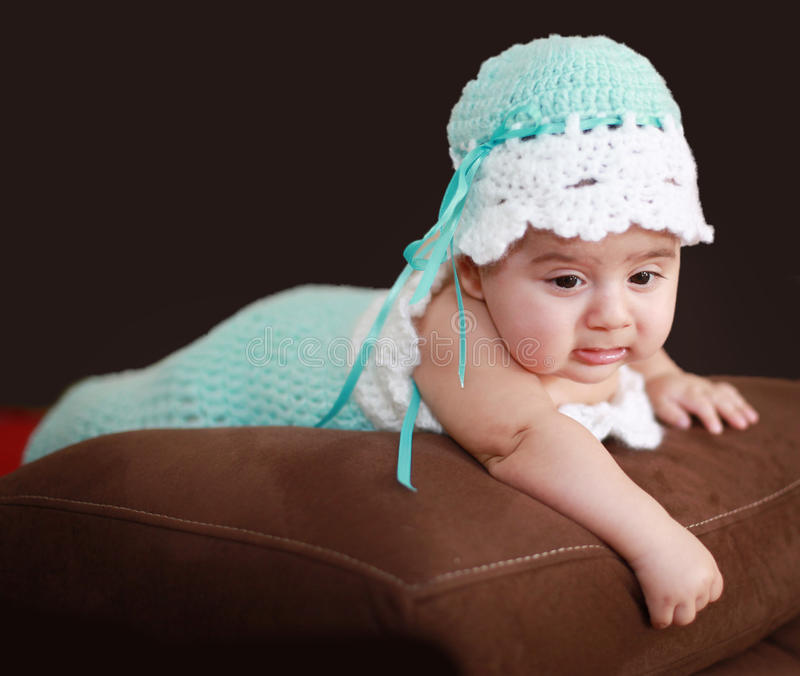 Baby in cocoon. A 4 weeks old baby in a crotched cocoon royalty free stock photography