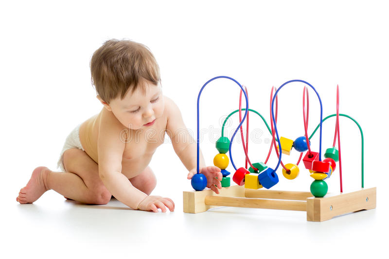 Baby with color educational toy royalty free stock image