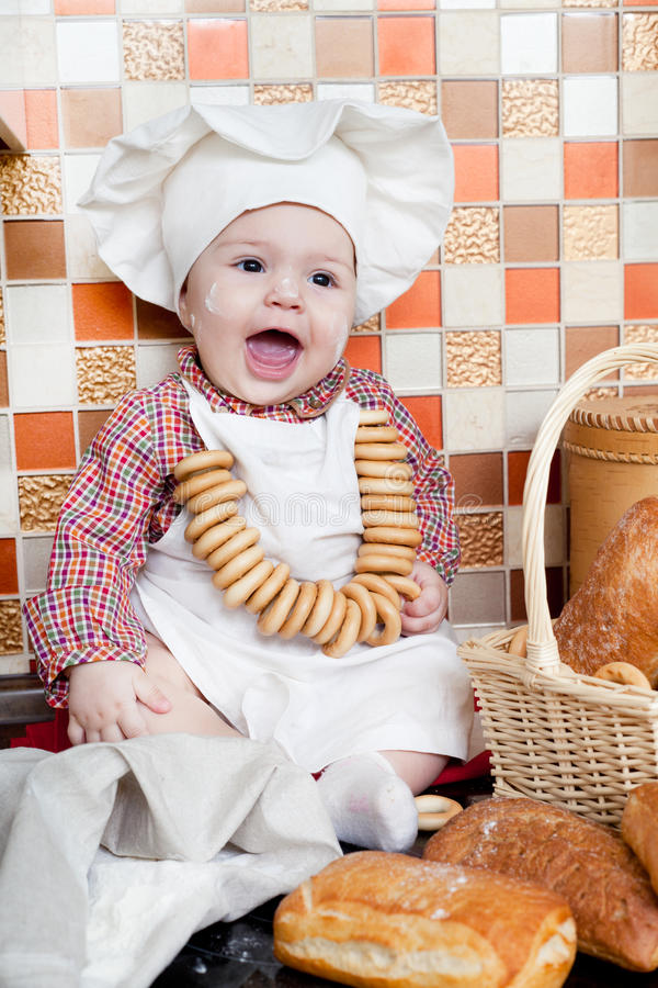 Download Baby cook with bread stock photo. Image of dinner, caucasian - 28863302