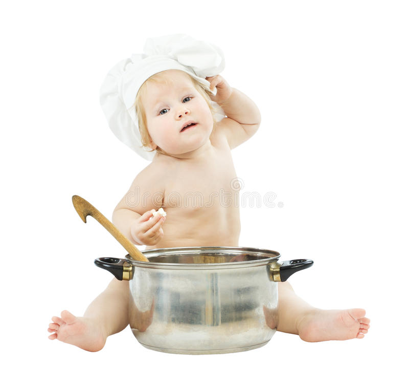 Baby cook in chef hat with big pot royalty free stock images