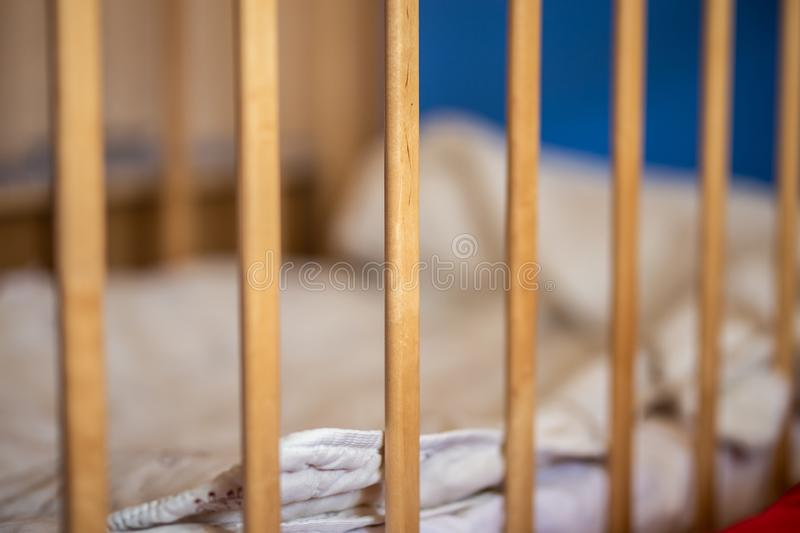 Baby cot, rods of crib, without child stock images