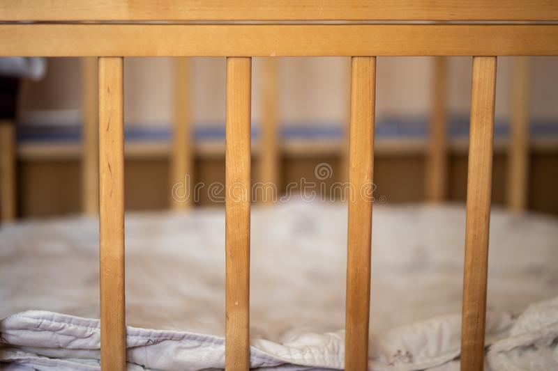 Baby cot, rods of crib, without child. Baby cot, rods of crib without child royalty free stock photos