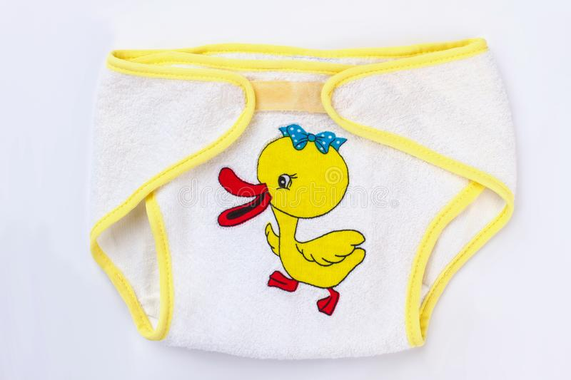 Baby cotton diapers with cartoon duck image, close up. Baby underpants on white isoalated background royalty free stock image