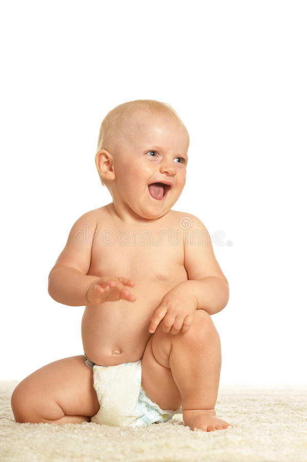 Baby crawling in nappy royalty free stock photos