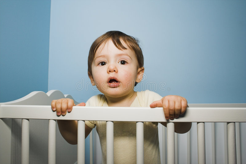 Baby in crib royalty free stock image