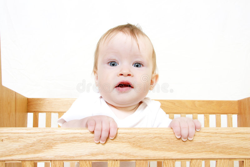 Baby In Crib stock image