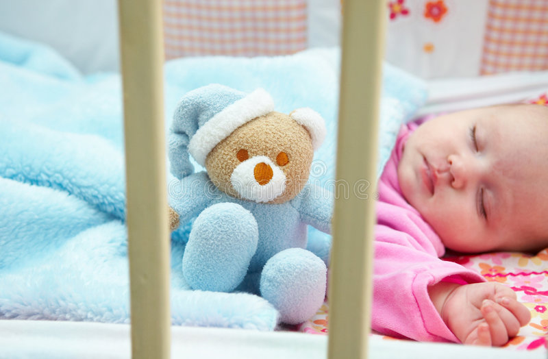 Baby in crib royalty free stock photos