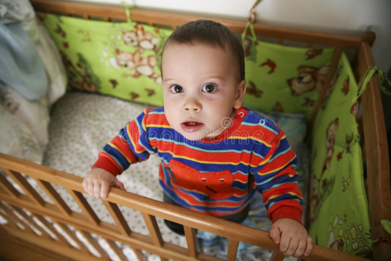 Download Baby In A Crib Royalty Free Stock Photography - Image: 5150777