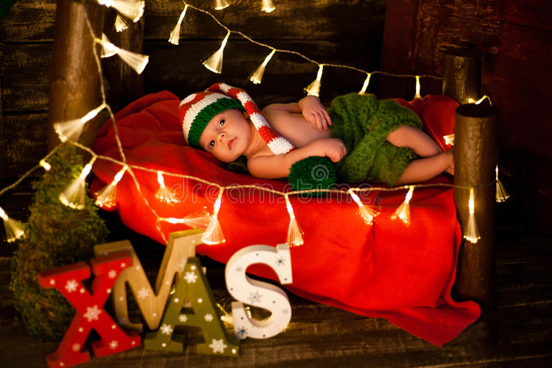 A baby in the crib at Christmas stock photos