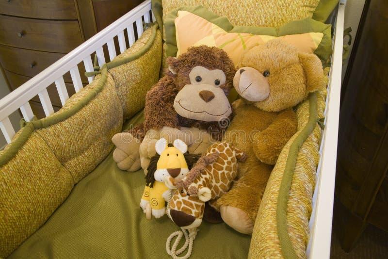 Baby crib and toys. stock photos