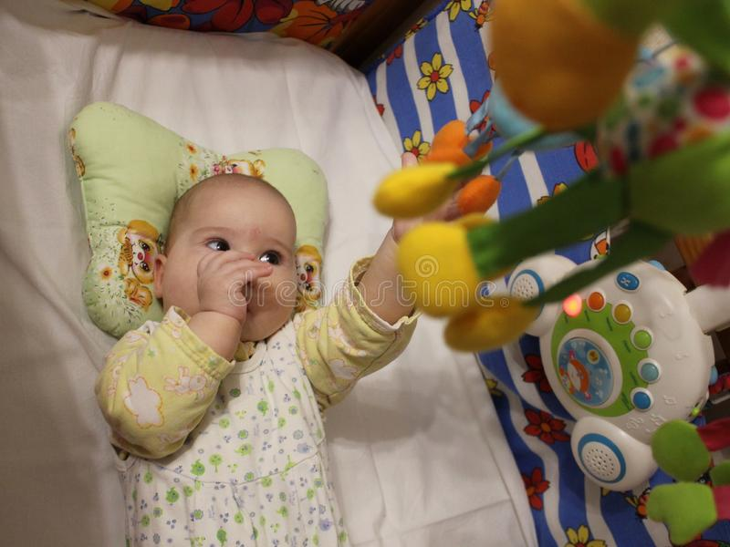 Baby with mobile stock photography