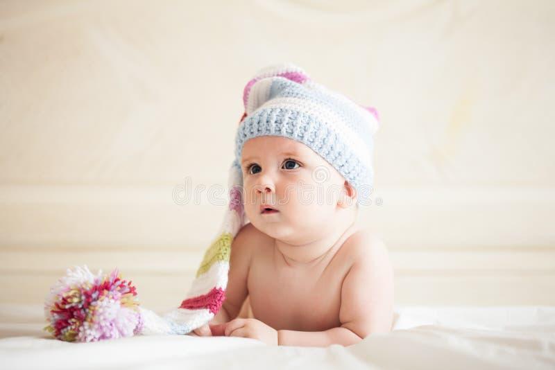 Baby in crochet hat stock images