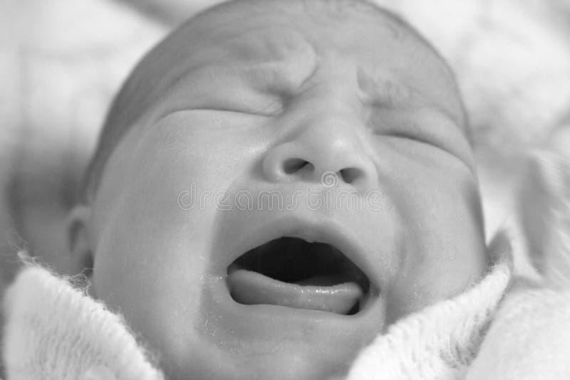 Baby cry stock photos
