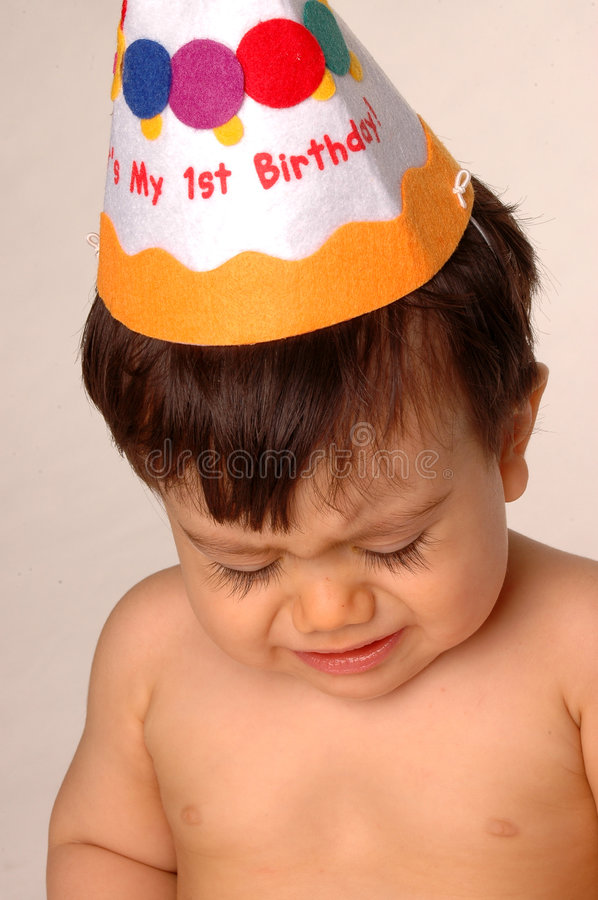 Baby crying on first birthday royalty free stock photography