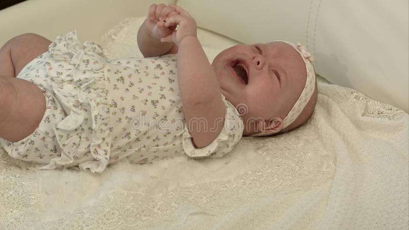 Baby crying on the bed royalty free stock photography