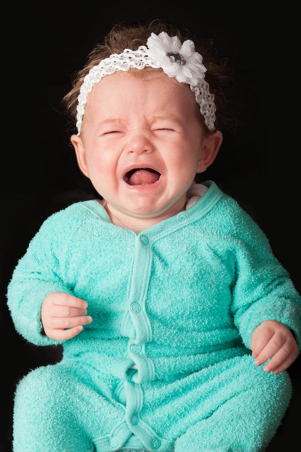 Baby crying stock images