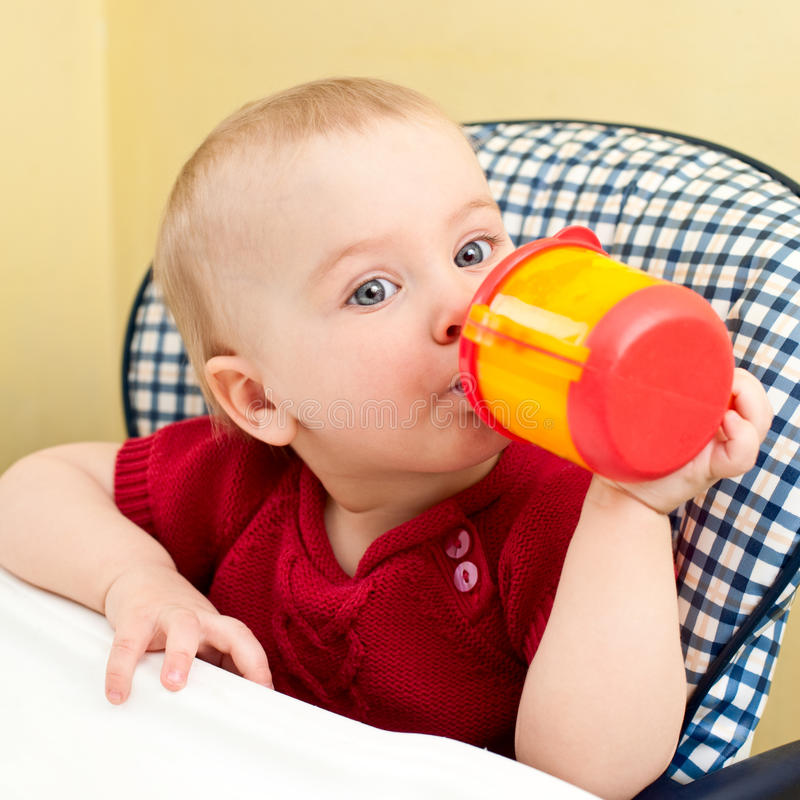 Download Baby with cup stock photo. Image of chair, person, child - 13733796