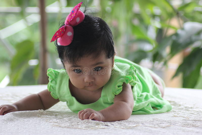 Baby cute. She posed like a professional model and she knows that shes on the camera royalty free stock photography