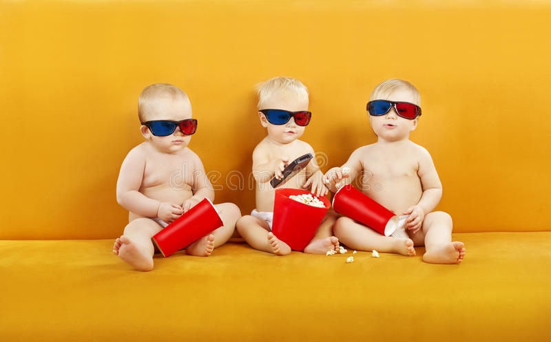 Baby 3D Glasses Watching Film On TV, Children Eating Popcorn And stock photos