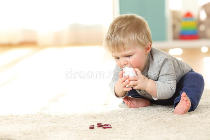 Perfect Download Baby In Danger Playing With A Bottle Of Medicines Stock Photo    Image Of Hurt