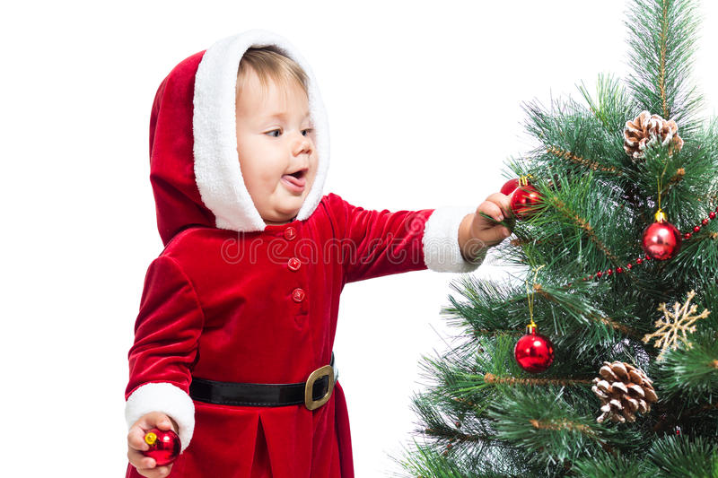 Download Baby Decorating Christmas Tree Royalty Free Stock Image - Image: 35080836