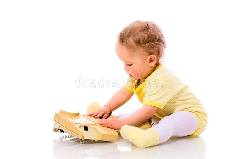 Baby dialing royalty free stock photos