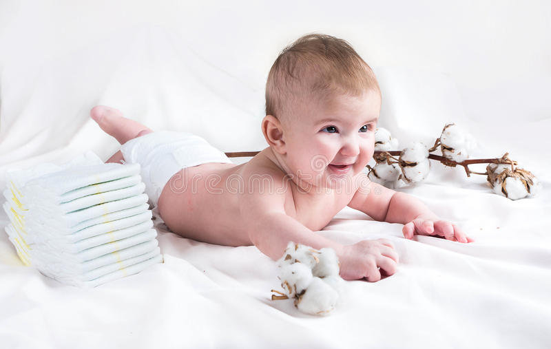 Baby in diaper on a white background royalty free stock photography