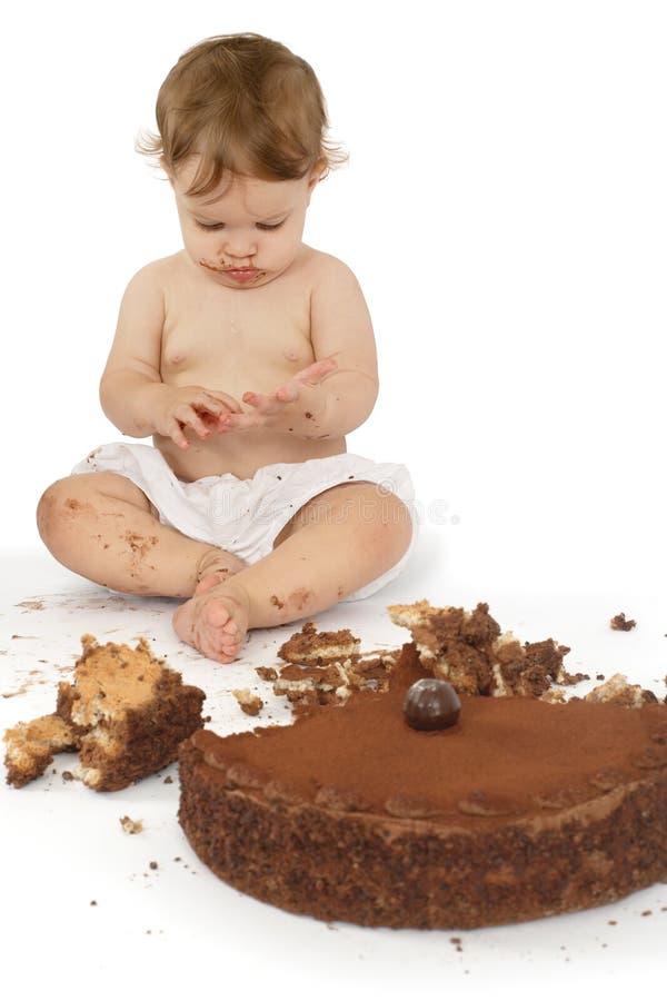 Baby die cake ontdekt stock foto's