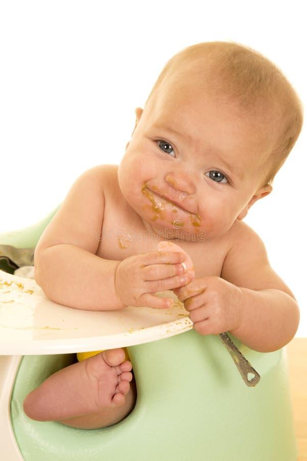 Baby die met slordig gezicht eten royalty-vrije stock fotografie