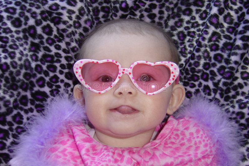 Baby Diva. Daughter playing dressup with mommy royalty free stock image