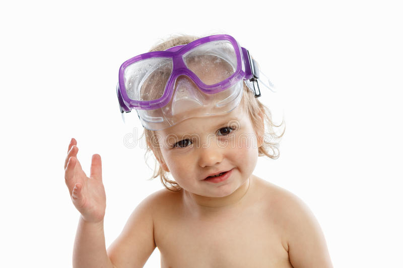 Baby diver in swimming mask with a happy face close-up portrait, on white. Background stock photo