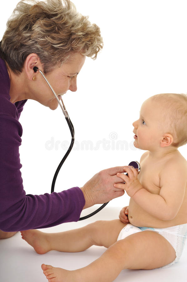 Baby with doctor stock photo
