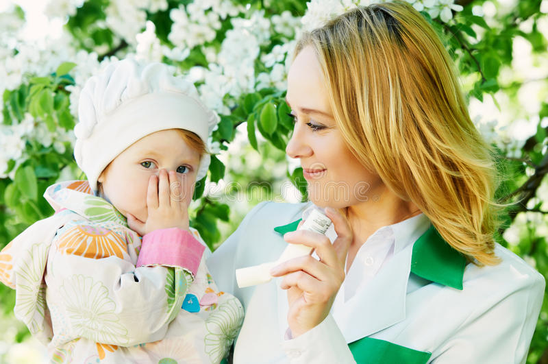 Baby and doctor with inhaler royalty free stock images