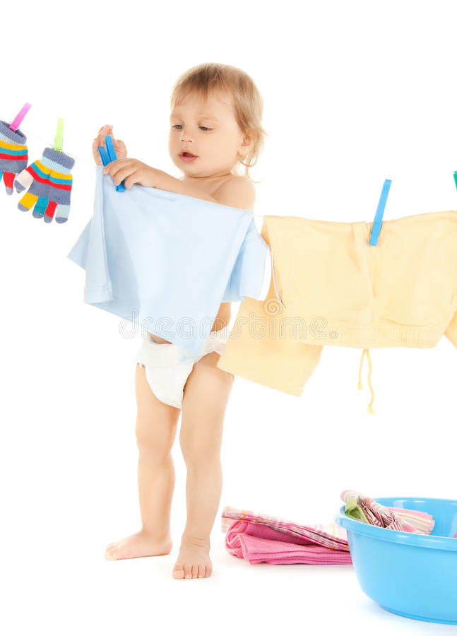 Baby Doing Laundry Royalty Free Stock Image