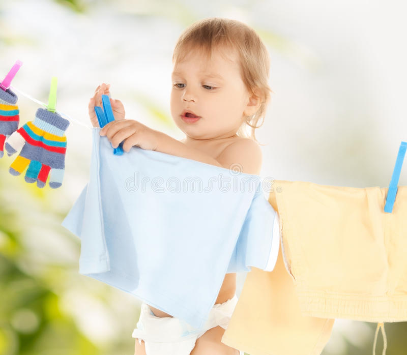 Baby doing laundry stock photo