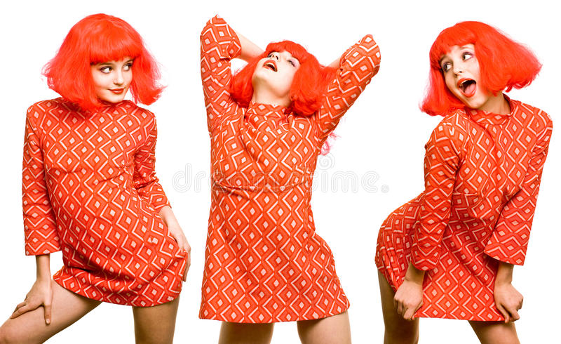 Baby doll expressive girl in red wig royalty free stock photos