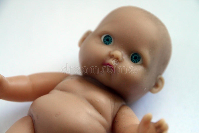 Baby doll, kids toy. Baby doll. Kids toy of newborn gazing blue eyed baby stock photography