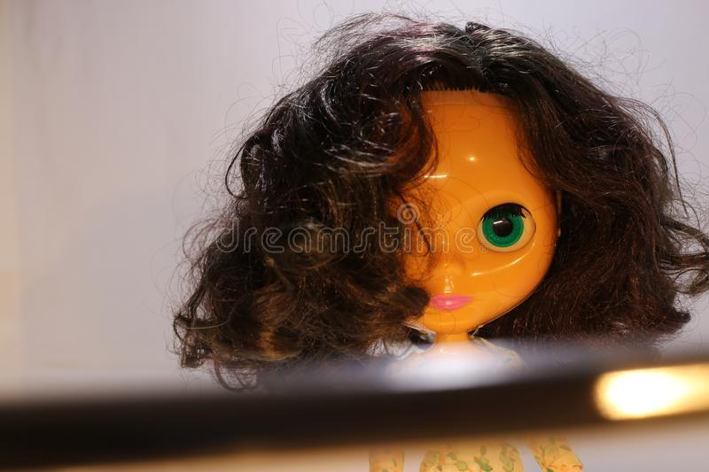 Ghost Doll on scary scenes, Halloween night. Baby doll look at the camera royalty free stock photos