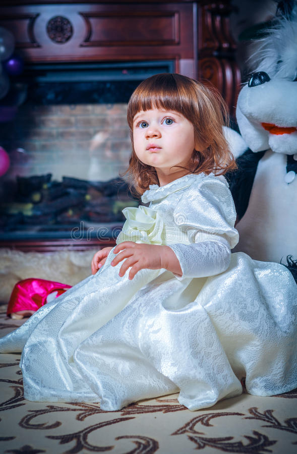 Baby dressed in white dress. Only Baby dressed in white dress royalty free stock photography
