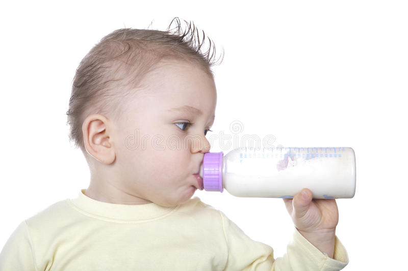 Baby is drinking milk stock images