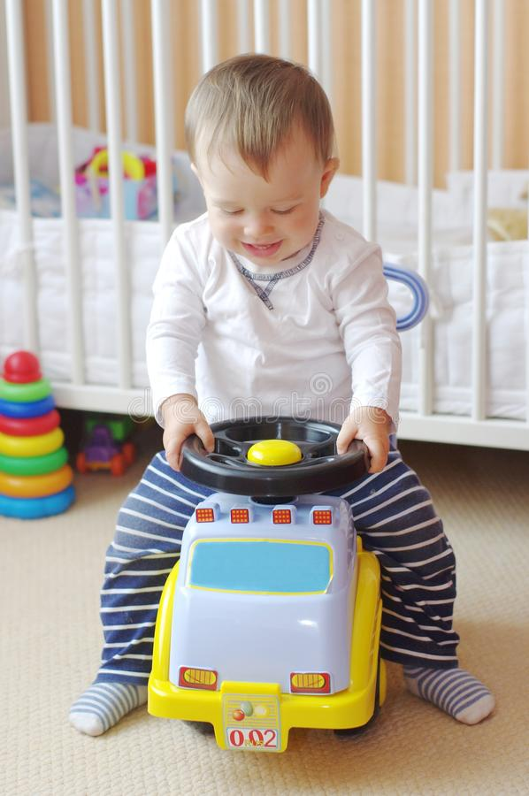 Baby drives baby car. Baby age of 1 year drives baby car stock images