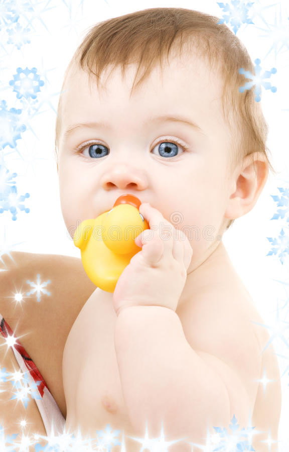 Baby with duck. Picture of blue-eyed baby boy with rubber duck royalty free stock photography