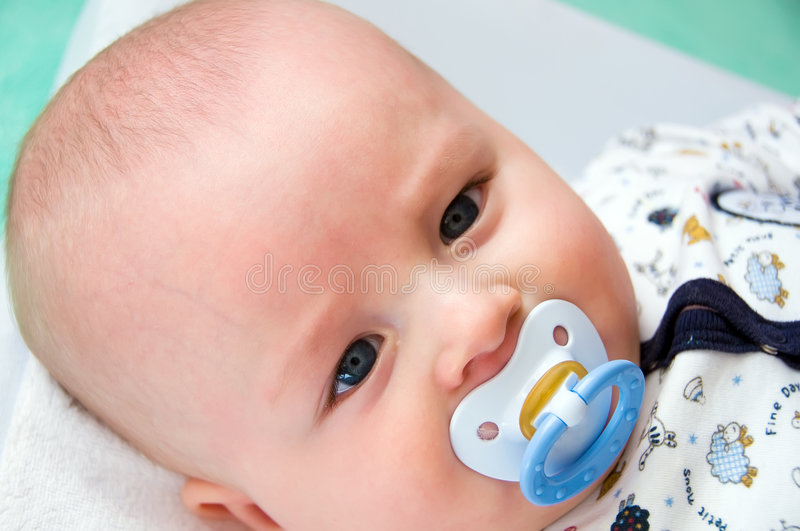 Baby with dummy - pacifier stock photos