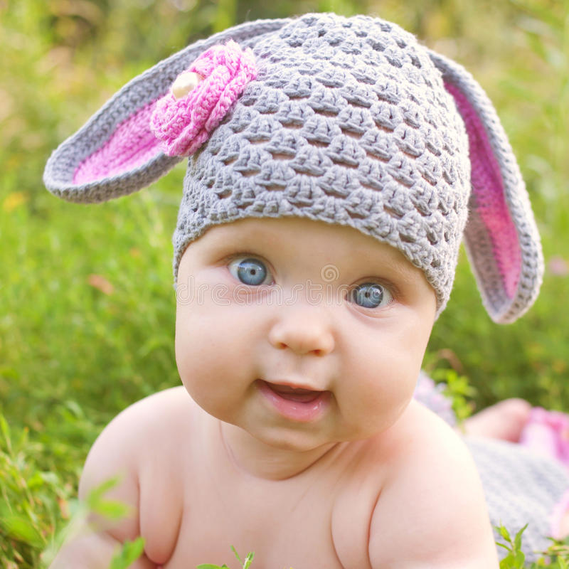 Baby easter bunny or lamb of green grass royalty free stock photos