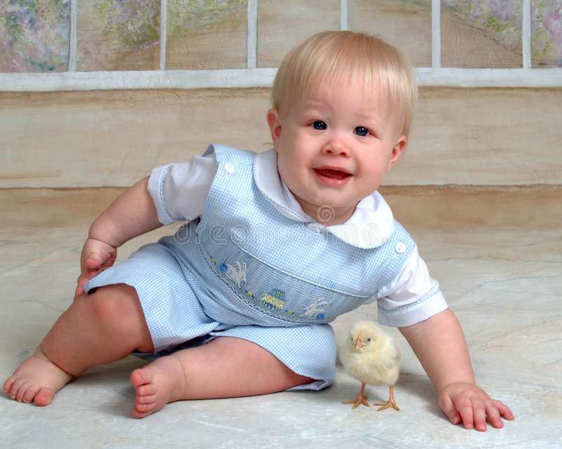 Baby and Easter Chick. Baby boy sitting with Easter chick royalty free stock images